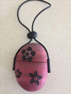 Purse made on a rock made with polymer clay by Lisa Haney
