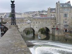Pulteney Bridge Bath England, crossing the River Avon, is like the Ponte Vecchio in Florence. They are two of a handful of historic bridges in the world with shops built into it.    photo©jadoretotravel