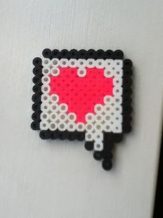 Cool perler bead heart speech bubble! It would look cute on a necklace too.