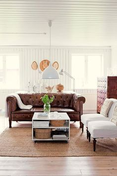 Lovvvee the brown leather couch...Swedish charm showcased on Lantliv, via Décor de Provence