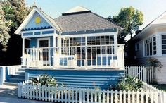 Sweet blue beach cottage with amazing windows over looking the front deck.  Trigg-Smith Architects - Project - A Transformed Beach Cottage traditional exterior