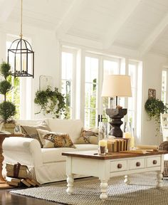 "A pretty room featured in the Pottery Barn website.  ""Making your home a little more beautiful can start in the one space where the family gathers the most, the living room."""