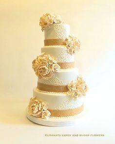 Piped wedding cake with ivory sugar flowers
