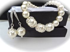 Pearl jewelry set ~ Brides pearl set ~ I LOVE this feminine pearl bracelet and earrings set. Perfect bridal jewelry. This set is bride worthy.