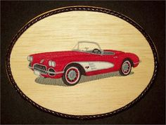 This unique 1960 CorvetteEmbroidery Balsa Wood Art, Classic Car Wall Decor combines the warmth of wood with the raised texture of 7 different thread colors and 24,404 stitches. The design was machine embroidered into a sheet of balsa wood, then cut and mounted on an oak stained 7 x 9 x 1 plaque. The black leather braided trim was added before a clear protective, non-yellowing acrylic matte finish was applied. A brass hanger is attached to the backside making it ready for hanging.    Balsa…