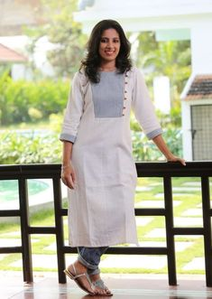 Plain white kurthi with bkie lines on the body