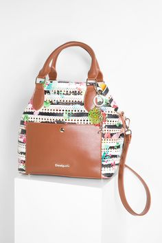Our 2 in 1 shopper bag has adjustable sides and straps and is as versatile as it is beautiful!