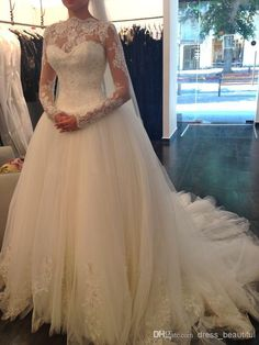 2014 Sexy Long Sleeve Ball Gown Wedding Dresses High Neck Backless Lace Applique Cathedral Train Beaded Sheer Bridal Gowns Church Wedding