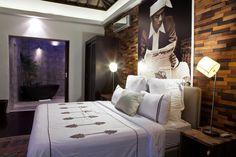wood tile wall in villa bedroom by Bo Design