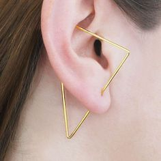 Gold Triangle Ear Climber, Triangle Earrings, Edgy Earrings, Designer Earring, Modern Earrings, Ear Crawler, Gold Earrings, Otis Jaxon, Gift Our best selling Triangle ear climbers are now available in 18K Yellow gold plating! This modern on-trend innovative design ingeniously blends earring and ear cuff to give you a geometric designer look without the pain of multiple piercings! Up your ear game and mix and match different shapes for a really edgy style statement, or wear a pair as…