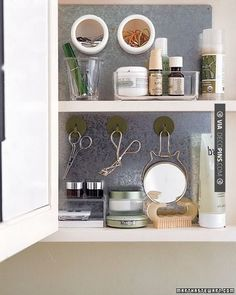 Nice - add a sheet of precut galvanized steel to interior of cabinet with construction adhesive. Magnetic hooks can hold scissors and a mirror, and small plastic cups with magnetic bottoms. | CHECK OUT MORE STORAGE IDEAS AT DECOPINS.COM | #storage #storage #closets #nooks #shelves #bookshelves #wallstorage #homedecor #homedecoration #decor #livingroom #walls