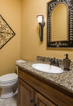 Deep yellow and black exotic wall decor -  interiordesign  bathroom