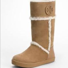 Tory Burch Amelie Shearling Boots size 11 fits like 10.5 The Tory Burch Amelie Shearling boots feature a suede upper with a round toe. The rubber outsole lends lasting traction and wear.  Color options: Black Height: Ankle Width: Medium Style: Cold weather Material: Regular suede upper and rubber outsole Toe shape: Round Heel height/type: 1-inch Shaft height: 10 inches Circumference: 14 inches Sole: Rubber Gender: Women Measurement taken from size: 5 Imported Tory Burch Shoes Winter & Rain…