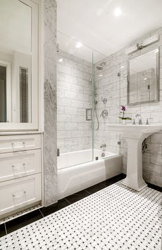 We used tile size and mosaic layouts in proportion to one another visually maximize this tiny New York City bathroom. Custom built-in cabinets with mirrored doors provide storage, and reflection as does using polished stone instead of honed. Surfaces and textures are important consideration in any design project!