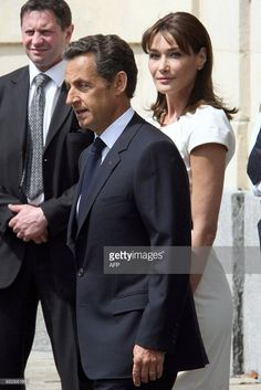 French President Nicolas Sarkozy and French First Lady Carla Bruni-Sarkozy leave the Caen Prefecture after a meeting with US President Barack Obama on June 6, 2009. US President Barack Obama joins the leaders of Britain and France and hundreds of World War II veterans Saturday to mark the 65th anniversary of D-Day on the beaches of Normandy. As star guest of the commemorations, Obama is to deliver a speech before 9,000 people including 200 US D-Day veterans at a clifftop graveyard in…
