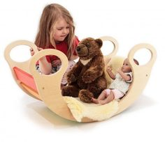 Another picture of the rainbow rocker. I like this much better than getting her a flimsy doll cradle.