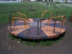 PICTURES of vintage playground equipment including monkey bars, metal slides, rocket slides, merry-go-rounds, spring riders and more. Playground Design, Playground Ideas, Merry Go Round Playground, Playground Toys, Childhood Days, 1980s Childhood, Outdoor Tables, Outdoor Decor, Play Equipment