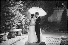 The happy couple making the most of the bad weather in the Grand Ballroom's courtyard.
