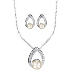 "Silvertone with faux pearls and rhinestones. Necklace, 16 1/2"" L with 3 1/2"" extender. Pierced earrings, 1/2"" L.     GOOD TO KNOW   All of Avon's jewelry is nickel-free for those with sensitive skin & allergies to nickel."