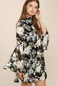 Whether you're the poet or the muse, you'll love the Inspire Me Black Floral Print Long Sleeve Dress! Ivory, grey, green, and blue floral print mingles across black woven poly as it falls from a mock neck, into a swing bodice with princess seams and flaring godets. Long bell sleeves. Hidden back zipper.