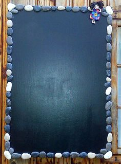 Portable black board recycled from an old discarded block mounted picture.