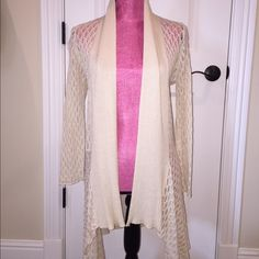 Lightweight crocheted cream cardigan Super lightweight and comfortable. Worn once with white cami and denim shorts. Perfect for summer. Size medium. Sweaters Cardigans