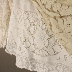 Does anyone remember the wooden stretcher frames the vintage lace tablecloths & curtain panels had to be pinned to after cloth was laundered? The cloths were too heavy to hang on line & had to be dried on the stretcher to maintain the shape. The little loops at the bottom of the white cloth in picture had to be looped over the pins, a two person job and tedious.