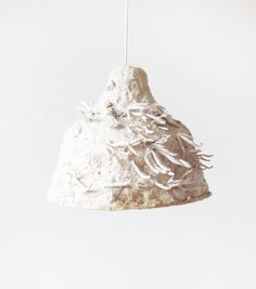 made of 'plant fibre and mushroom-mycelium. The lamp is grown into shape during a period of weeks, where the mushroom mycelium grows together the plant fibres into a flexible and soft living textile Edible Mushrooms, Stuffed Mushrooms, Natural Lamps, Green Furniture, Plant Fibres, Jar Lights, Sustainable Design, Sustainable Living, Diy Design