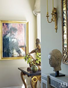 Michael S. Smith paired a Francis Bacon painting with antique Buddhas and an antique Swedish table in this Manhattan apartment.