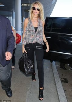 Effortlessly chic: Rosie Huntington-Whiteley  turned up at Los Angeles International Airpo...