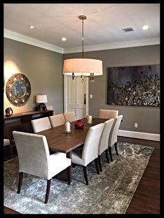 My after photo of my dining room in my Houston house after a year of remodeling work to turn a traditional styled house into a more contemporary/transitional family home.  Learn more at my blog No Fixed Abode 4 Sue