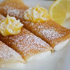Lemon Crepes with a sweet, smooth filling with lemon curd on top.