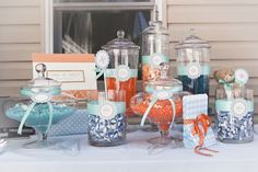 orange and blue first birthday party candy dessert table