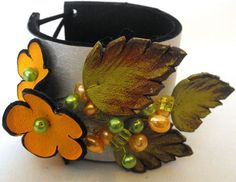 Gorgeous leather floral cuffs by Julishland in Israel.