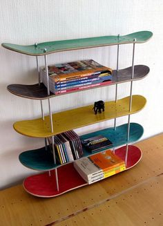 This is an awesome decor to have in your house and I like how they used Skateboards to be made in a shelf .
