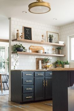 Floating shelves in the kitchen is becoming a big design trend in kitchen renovations. Show off your unique kitchen appliances and decor items. Kitchen Redo, New Kitchen, Kitchen Remodel, Kitchen Wood Shelves, Open Shelves, Shelves In Dining Room, White Tile Kitchen, Open Cabinets In Kitchen, Plants In Kitchen