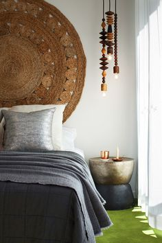 Rug as Headboard, pendant lamps with large beads. Love those!