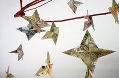 DIY origami star mobile close-up by annalea hart How To Make Origami, Useful Origami, Origami Easy, Origami Paper, Homemade Baby Mobiles, Origami Owl Disney, Origami Wedding Invitations, Origami Owl Parties, Origami Lotus Flower