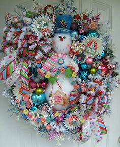 Hello, I am so glad you took the time to stop in and take a look around. This listing is for a custom made to order OUTSTANDING & UNIQUE XL large Snowman wreath, loaded!!!! The wreath in the photo is not the wreath you will be getting but, I can make you one very similar. Some items will be different depending on supply availability. I can only make one.    Your wreath will be LOADED with goodies! I will add a large plush lighted snowman.. I will also add lots of Christmas ornaments, pink…