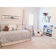 A light and airy star and airplane themed big boy room.