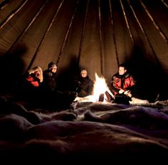 Staying in a lavvo (sapmi tent) in the middle of the Finnmark Plateau, watching the northern lights up close and enjoying fresh fish caught under the icy lake in Norway