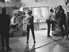 "Mary Tyler Moore (back to camera) waits for her scene backstage on ""The Dick Van Dyke Show.""  Photo Credit: Library of Congress"