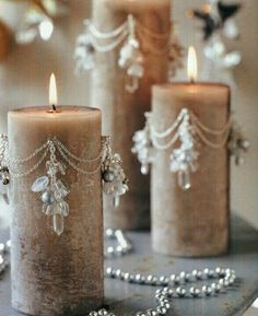 Great idea to decorate candles , I think these will be pierced gorgeous dangly ear rings stabbed into the candle Anna Www.melodymaison.co.uk