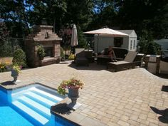 An outdoor fireplace complements any pavingstone patio.