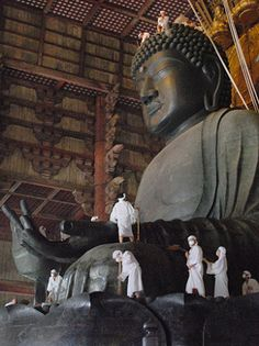 "Ominugui お身ぬぐい - Monks and volunteers clean a year's worth of grime from the head of the 15-meter-tall statue of Buddha at Todaiji temple in Nara, Japan. The annual sprucing up of the statue completed in the year 752 is known as Ominugui"" (Wiping of the body). In total, 110 monks and others usually take on the duties."