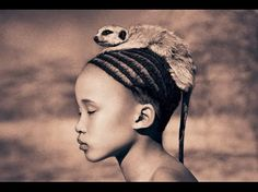 LOVE the child's face in this pic, not so sure about the rat on his/her head though.