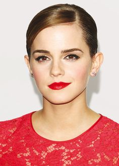 Holiday makeup look - Emma Watson with red lips, lined eyes, and heavy lashes.