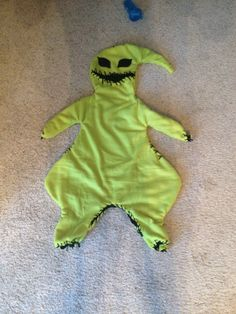 Toddler Nightmare before Christmas oogie boogie costume!!!!! All u need is black yarn, 2 fleece 3 dollar blankets, and a canvas sewing needle!!! Trace around toddler, or in my case the clothes of said toddler, cut out  2 ply of green and 2 ply of black fleece blankets, sew together with yarn using large bites with black on the outside, invert, cut mouth hole (this is where child's head/face will show through) and decorate with eyes and additional throws on the outside.
