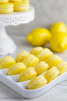 Lemon French Macarons- perfect spring-flavored confections with zesty lemon buttercream, plus video tutorial on how to fold the batter. * maybe lavender macaron with lemon filling? Lemon Desserts, Lemon Recipes, Just Desserts, Sweet Recipes, Baking Recipes, Cookie Recipes, Delicious Desserts, Dessert Recipes, Yummy Food