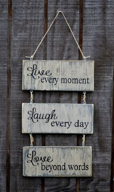 Live Every Moment Laugh Every Day Love Beyond Words Wood Hanging Sign, Handpainted. $30.00, via Etsy.